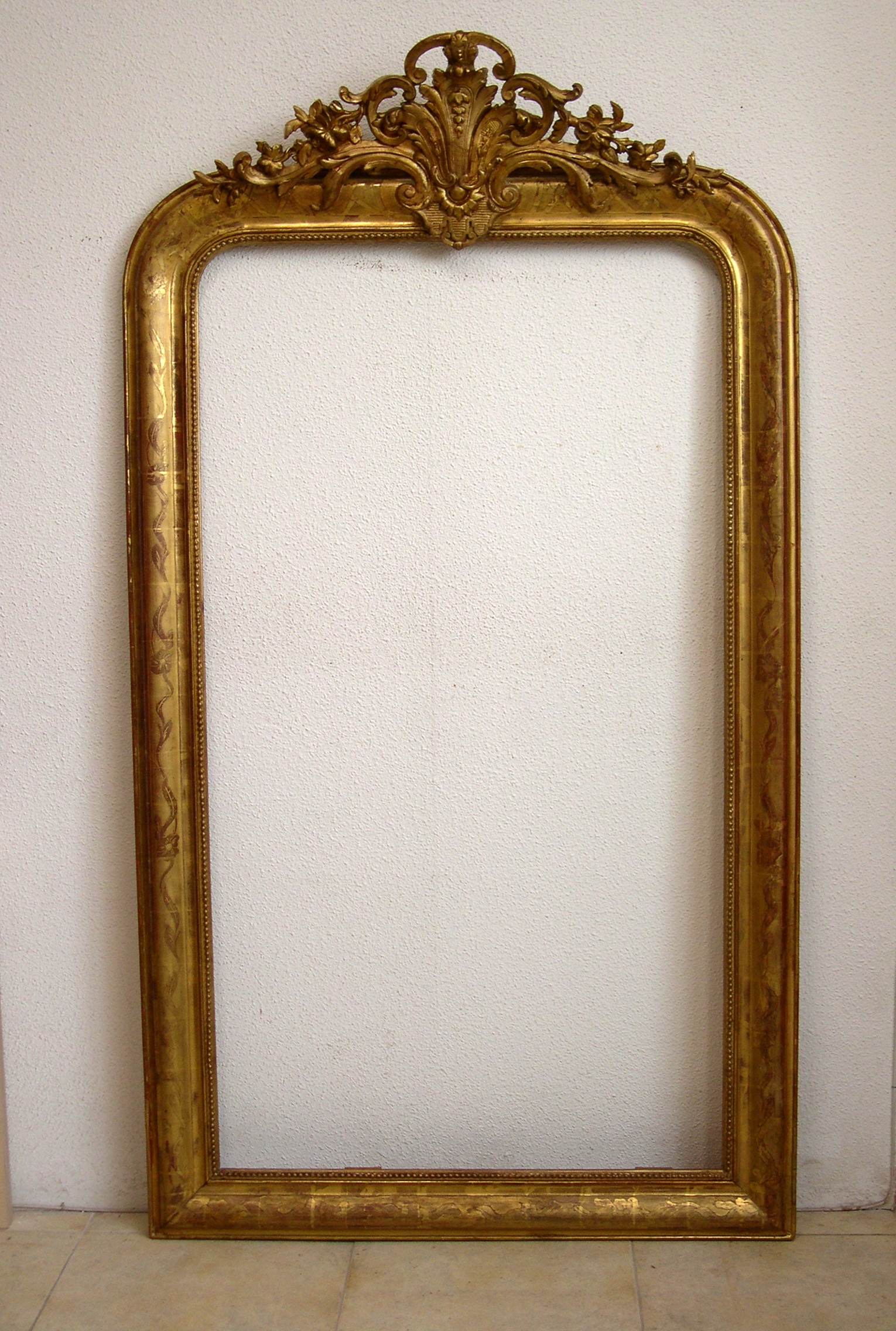 Marco dorado de espejo tras la intervenci 1530 2272 for Espejo marco dorado